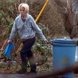 Poor old Ruthie Madoff hauling in the trash barrel at her son Andrew's Old Greenwich Village home where she resides.