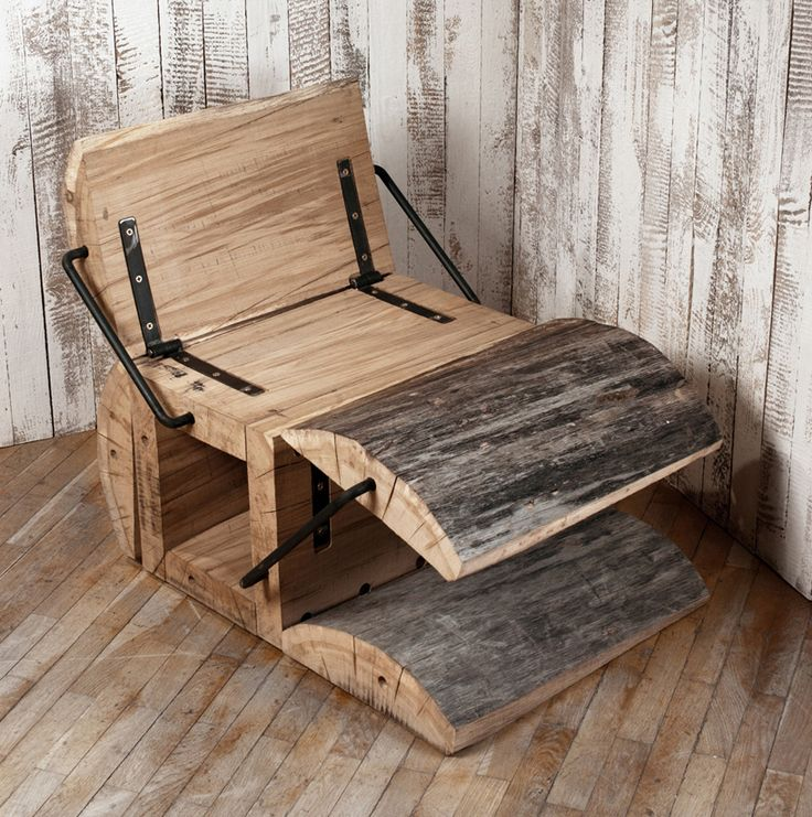 waste less log chair by architecture uncomfortable workshop. Using  the waste remains of reclaimed  oak timber logs after being processed to wood beams, and created 'waste less chair' - an expandable  seat that integrates two open positions, one as a rocking-chair, and one with a leg rest.  when not in use, the piece can be fully closed by collapsing it into its natural form.