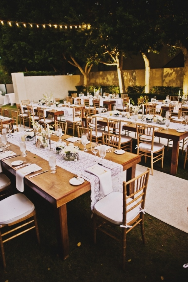I love family style seating/wood tables | Wedding ...