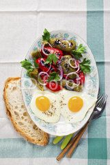 fried eggs and salad