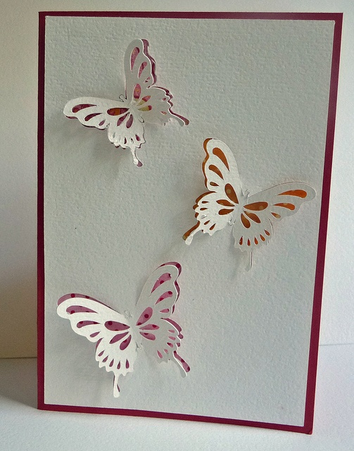 Butterfly card with paper showing though underneath.: