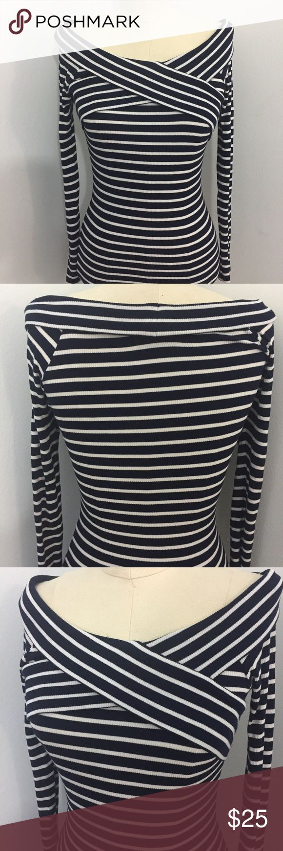 Topshop Super Tight Shawl Collar Knit Dress This cute dress is navy blue and white striped. It is a red T-shirt dress. Super tight with a shawl collar. Excellent preowned condition. Topshop PETITE Dresses Mini