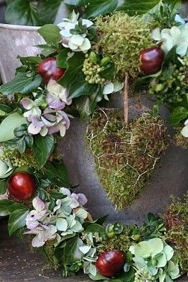 hydrangea, red apples, green moss heart wreath  . Pops with color arranged so sweet