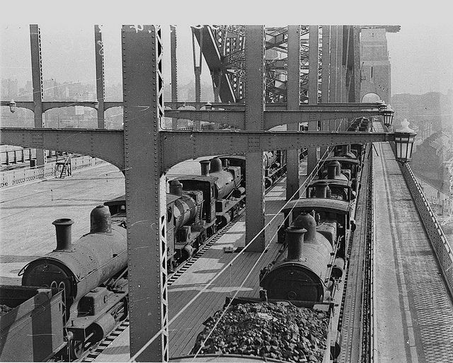 Load-testing of Harbour Bridge when fifty steam locos were run on western side, February 1932, by Ted HoodBy State Library of New South Wales collection