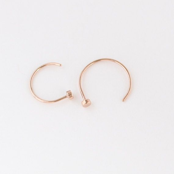 Nose Ring Hoop Rose gold plated over 316L Surgical Steel 22g, 20g & 18g 5/16 =8mm 3/8 =10mm I make these from rose gold plated surgical steel wire and shape them, the head is hammered and smoothed, and the end for inserting is smoothed for comfort. This listing is for one nose ring. Thank you for browsing or shopping.