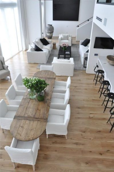 Black and white room with beautiful oval dining table made of pallets