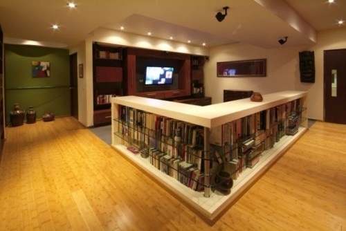 counter-level bookcase adds privacy, book storage and a clearly defined and cozy television watching space. Perfect for huge open basements (contemporary basement by Aurelio Vazquez)