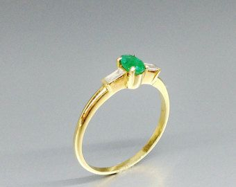 Fine Emerald solitaire engagement ring with two diamond set in 18K gold - gift idea by gemorydesign. Explore more products on http://gemorydesign.etsy.com