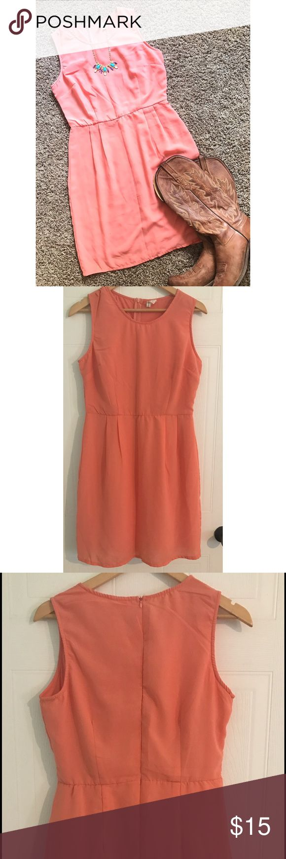 Peachy Coral Sundress Pretty peachy-coral sundress -- can be easily dressed up or dressed down.  Fabric is sheer, but fully lined.  Zips in the back.  Sizing is Juniors Large, and runs small; the equivalent of a Misses Small.  Hits above the knee. Dresses