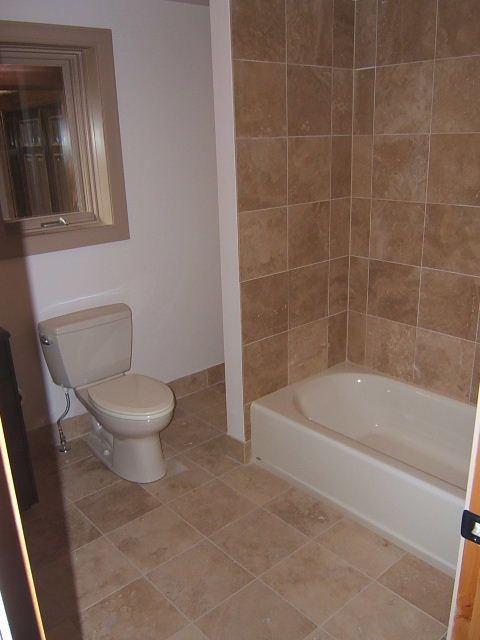 Tub tile matching floor tile mixed with drywall Floor tile design ideas for small bathrooms