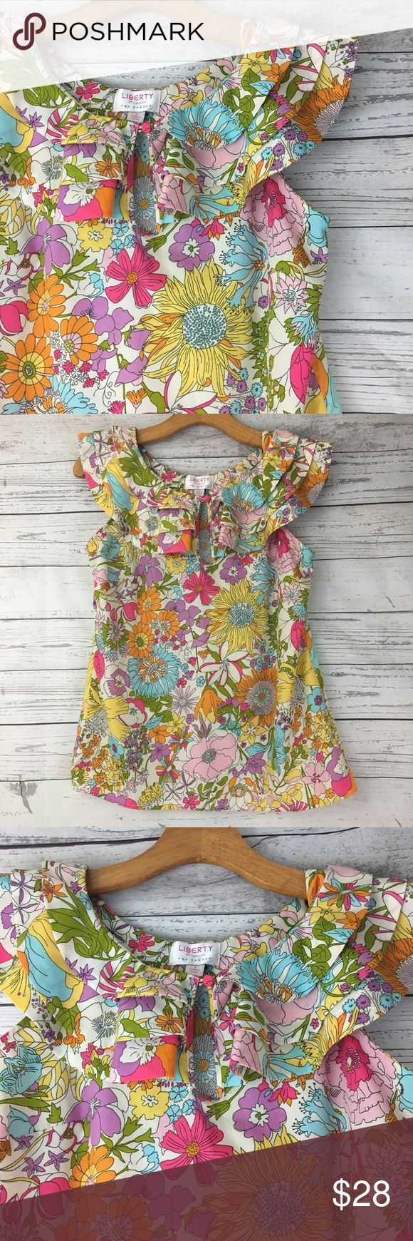 """Liberty for London Target floral ruffle blouse Liberty for London for Target floral blouse with a ruffle already my the neckline. This top is sleeveless and has a button keyhole on the front. This bright top is perfect for spring and summertime!  Measurements pit to pit 17.5"""", length 24"""" EUC  D1 Liberty for London Tops Blouses"""