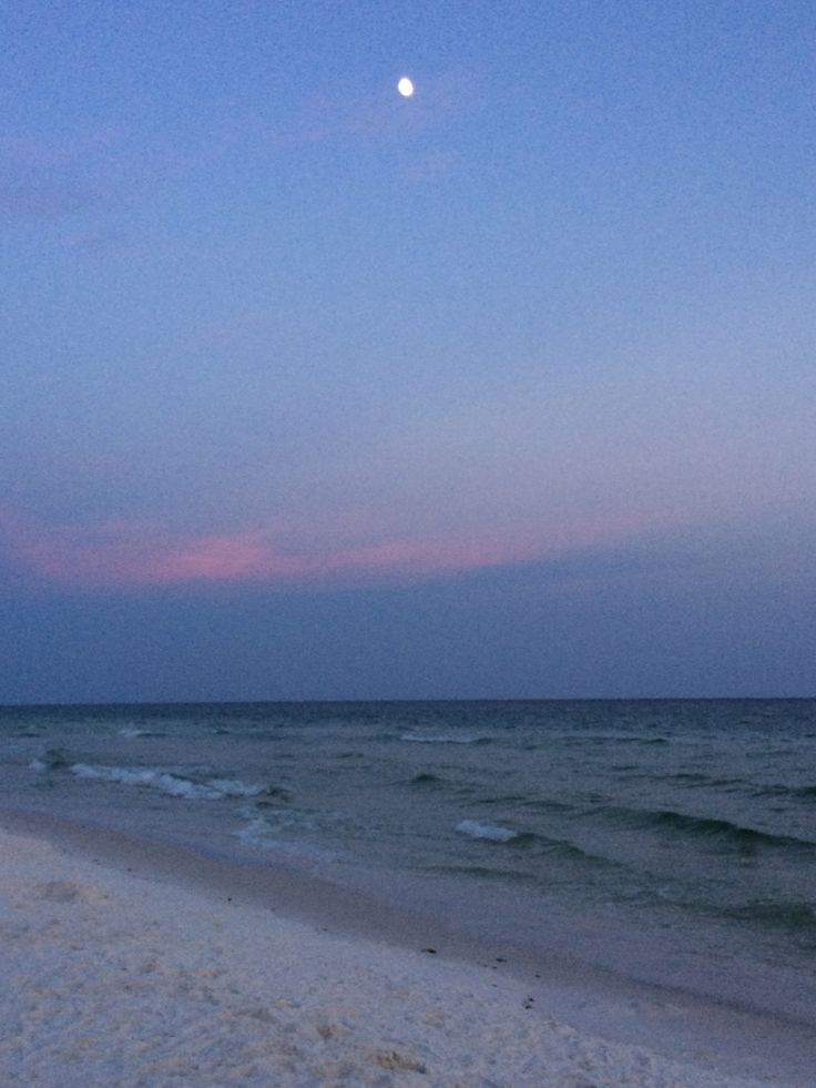 This is such a pretty view I love the moon with the ocean below it!!!