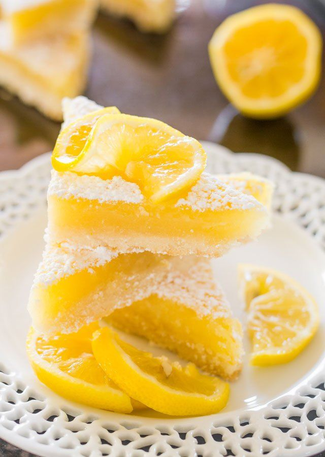 Lemon Bars - A classic recipe with a shortbread crust and a tart and lemony curd filling. These lemon bars are luscious and totally scrumptious.