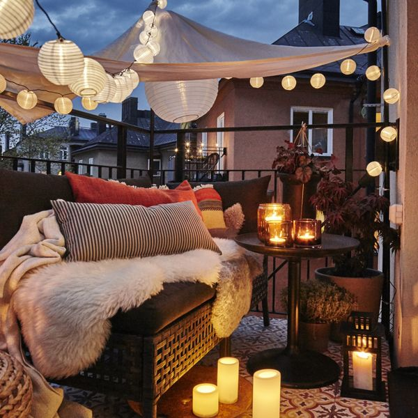 Add IKEA SOLVINDEN decorations to a string of lights to turn your porch, balcony or patio into a dreamy outdoor oasis!