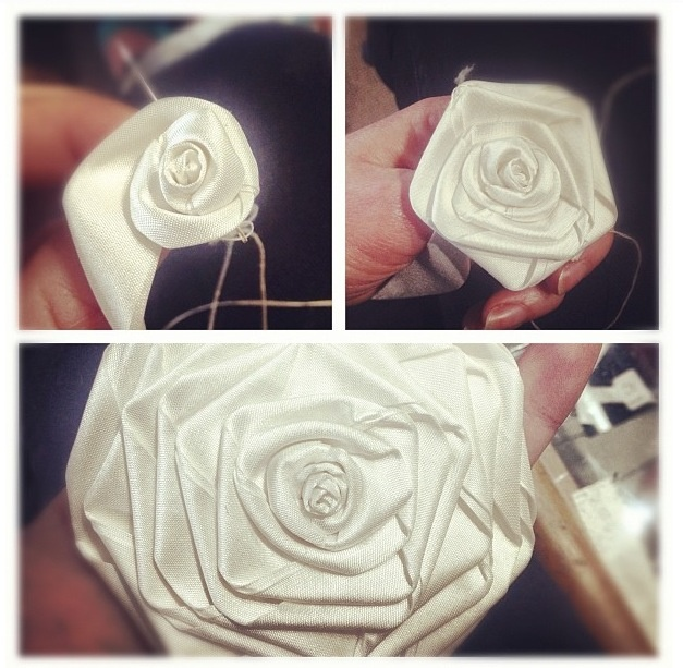 Making a silk rolled rose for a wedding dress.