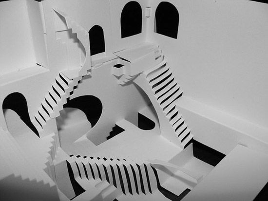 """M.C. Escher's """"Relativity"""" cut and folded in paper from a single piece of 8.5″x11″ cardstock, without use of glue or other adhesive."""