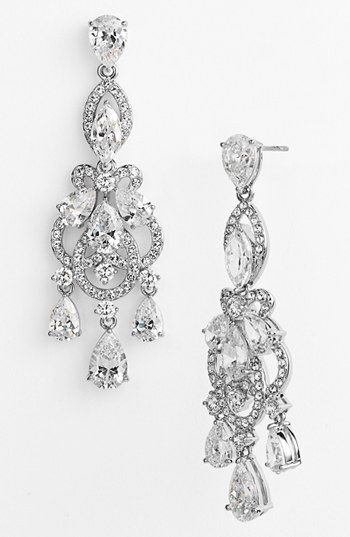 Earrings like this are not just for weddings. On the right woman, they should be every day. She has True Winter or Bright Winter colouring, or maybe even Bright Spring. Rachel, I guess she wears decoration well but they might be too delicate for a yinDramatic woman who would make them look like toys and she would seem very big? A Romantic face wants more rounded softness. Maybe a YangR?