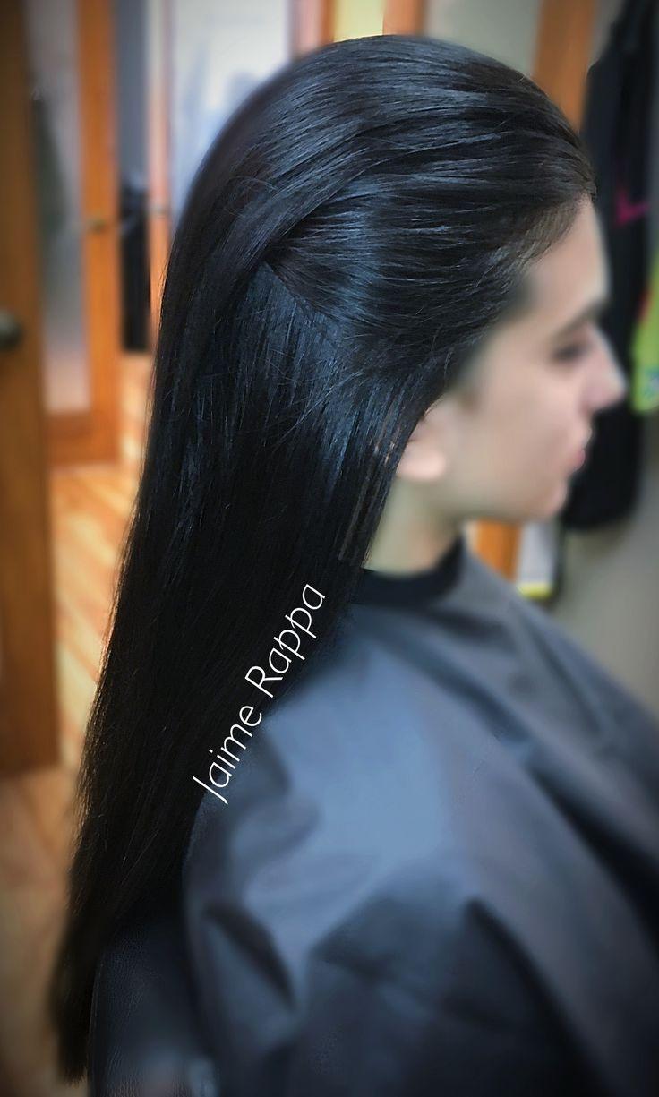 Dark brown straight thick hair slicked back. Kardashian inspired