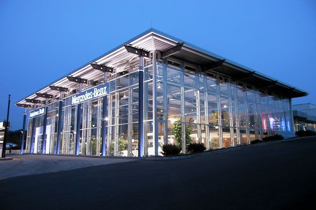 Automobile showroom with glass facade google search for Car showroom exterior design