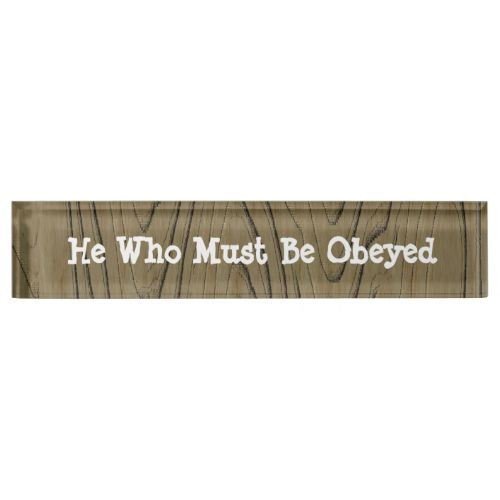 """A fun desk sign makes an ideal novelty gift for a family member, co worker or boss, in a wood grain effect and white writing. Feel free to change the words, """"He Who Must Be Obeyed"""" to suit your needs. #funny-signs #fun #co-workers-gifts #boss-gift-idea #wood-effect #wood-grain #name-sign #bossy-person #he-who-must-be-obeyed #male-boss #wood-signs #title-signs #funny-desk-decor #fun-desk-plate #office-banter #funny #tongue-in-cheek #novelty-gifts #male-novelty-gifts #husband"""