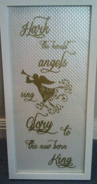 Christmas frame using silhouette and gold vinyl.