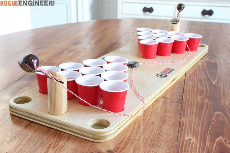Build your own mini beer pong game from a small piece of plywood. A perfect holiday gift for your drinking buddy!  | Free Plans | rogueengineer.com #MiniBeerPongGame #ManCaveDIYPlans