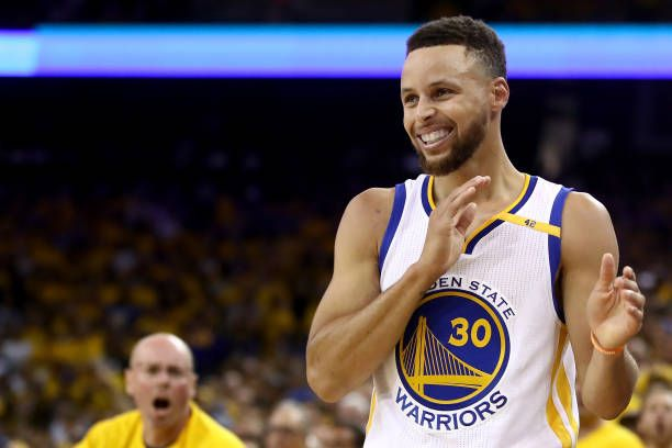 Stephen Curry of the Golden State Warriors reacts to a play in Game 5 of the 2017 NBA Finals at ORACLE Arena on June 12 2017 in Oakland California...