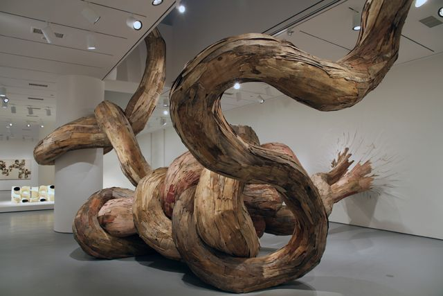 Brazilian artist Henrique Oliveira shows absolutely no respect to art galleries' walls! It's as if he has the supernatural ability to control trees, making them burst through the walls at his own whim.