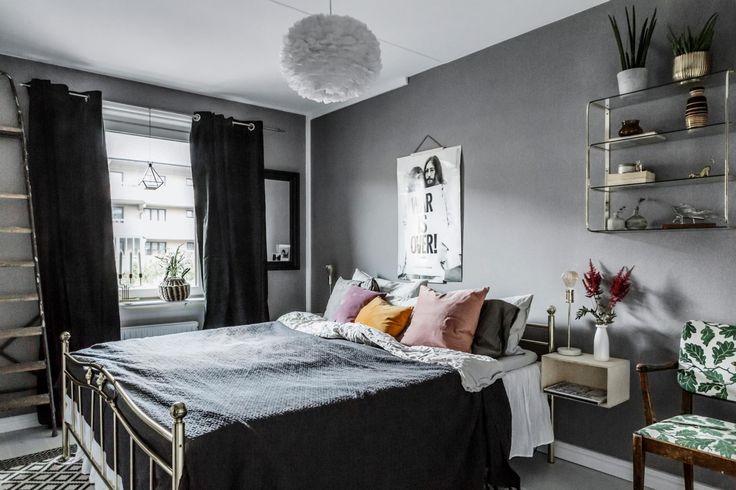 Grey bedroom with colourful cushions