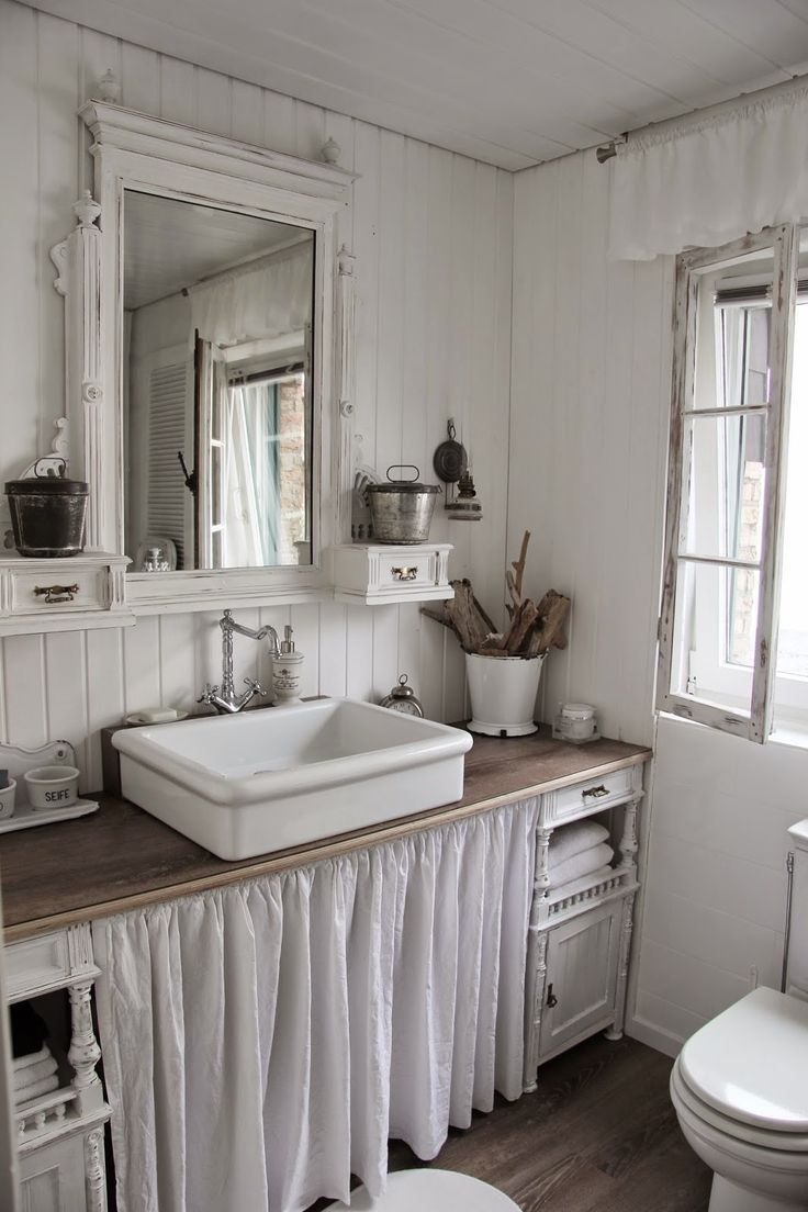 "This is in a bathroom, but it illustrates what I want in the kitchen. A farmhouse sink placed above the countertop, the same as vessel sinks in the bathroom. They're too low otherwise (except for people who are 4'11"" I suppose)."