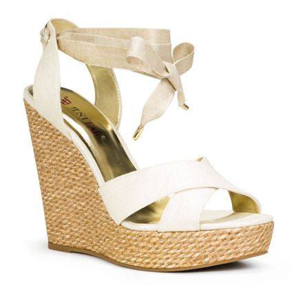 Win $500!  This JustFab wedge harkens back to the glamour of Grace Kelley!  Soft white with satin ribbon all atop a classic wedge with the twist of a modern platform!  You will be ready for your close-up of your perfect pedicure now!