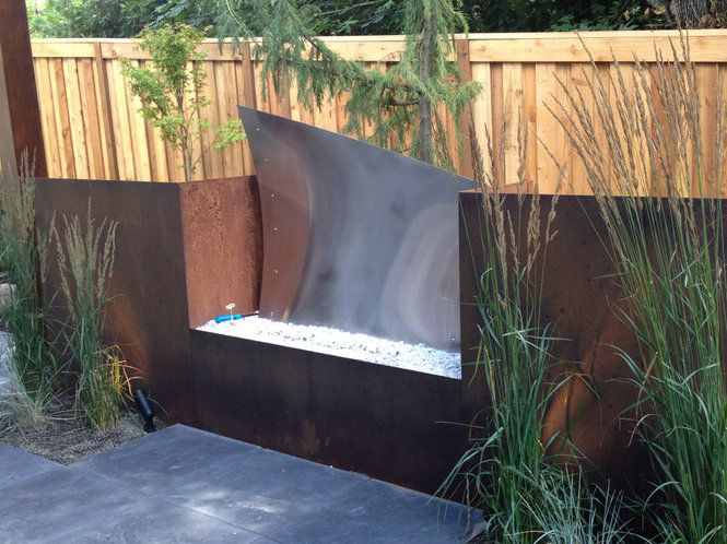 Contemporary outdoor fireplace adds sophistication