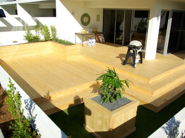 That is our Premium Treated Pine Decking. Clear H3 Treatment used to preserve natural Pine Colour This deck and garden has been built over a concrete rooftop by the guys at I Landscape.  Timber Flooring, Decking, Screening - Bamboo, Pine, Spotted Gum, Modwood, Ironwood & Ironbark - Directline Timbers