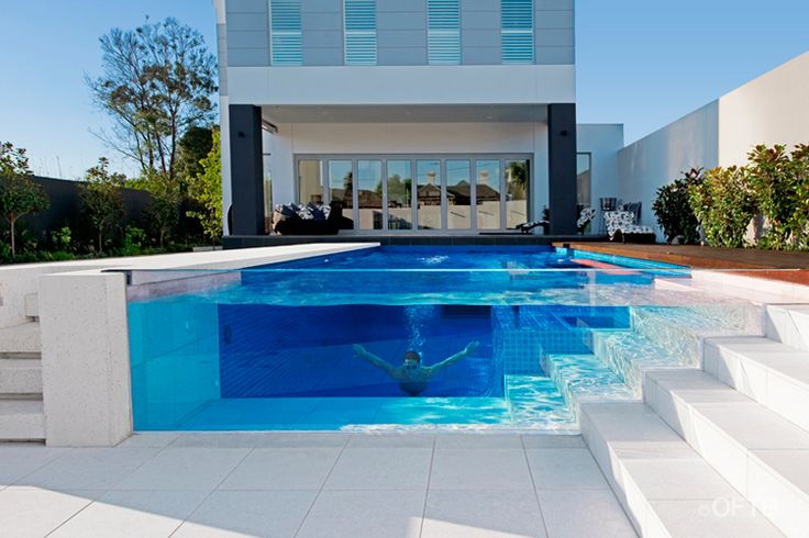 A pool with glass sides, one of which looks into the basement of the house - now I have to reconfigure my whole dream house floor plan.