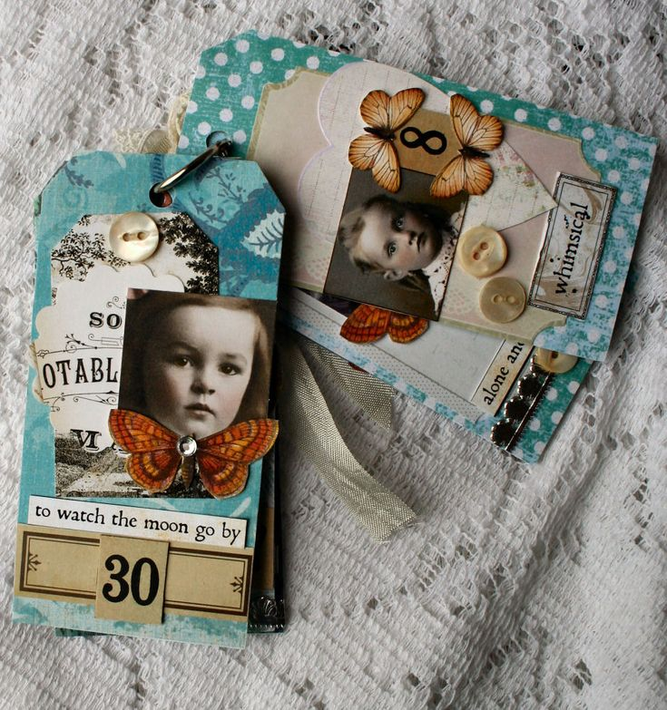 Tags with scrapbook paper, copies of old photos, phrases, butterflies, and buttons.