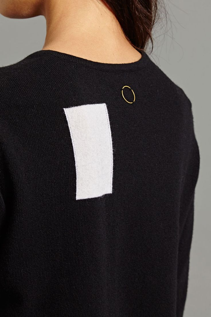 Pao Pullover In Black With Cream. This pullover is made from a supremely soft cashmere and wool blend. It features one of the trademark details from the AW15 collection: a contrasting graphic shape knitted into the left hand side of the back. It is an unexpected addition to our essential long-sleeved, round neck pullover.