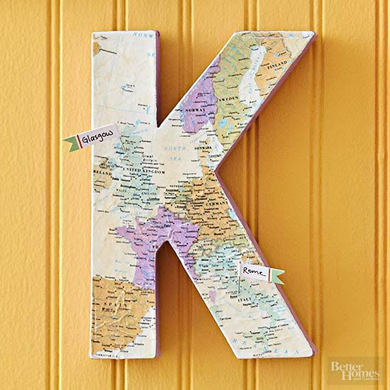 Commemorate a special vacation shared with your loved ones with a map-covered monogrammed letter. Use decoupage medium to adhere a map to the front of a papier-mache the letter. For extra durability, brush the surface with a second coat of medium and let it dry before adding flag-top pins to mark your visits or favorite cities. /