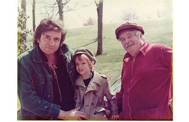 Johnny Cash at home with John and June's dad