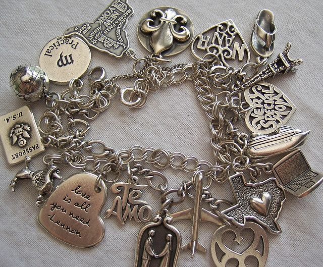 James Avery charm bracelets...  Hey, that's my bracelet!  Someone found it on Flickr and pinnned it on Pinterest.  Cool!   I need to post an updated picture, though.
