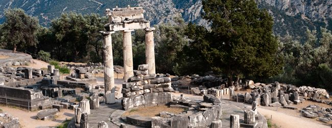 DELPHI:- Central among the number of imposing ruins that are interspersed on the Southern slopes of Parnassos mountain is the temple of Apollo.