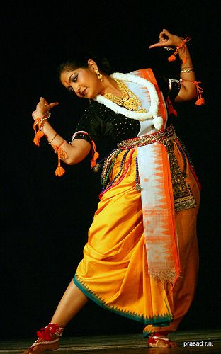 manipuri dance. This female dancer is dressed in the attire of a male character in the performance.