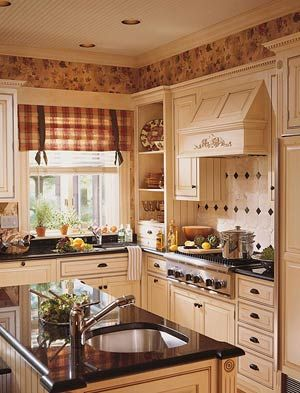 This looks similar to my kitchen (same colors except I have butter colored walls and whiter trim)  I want that stove hood!