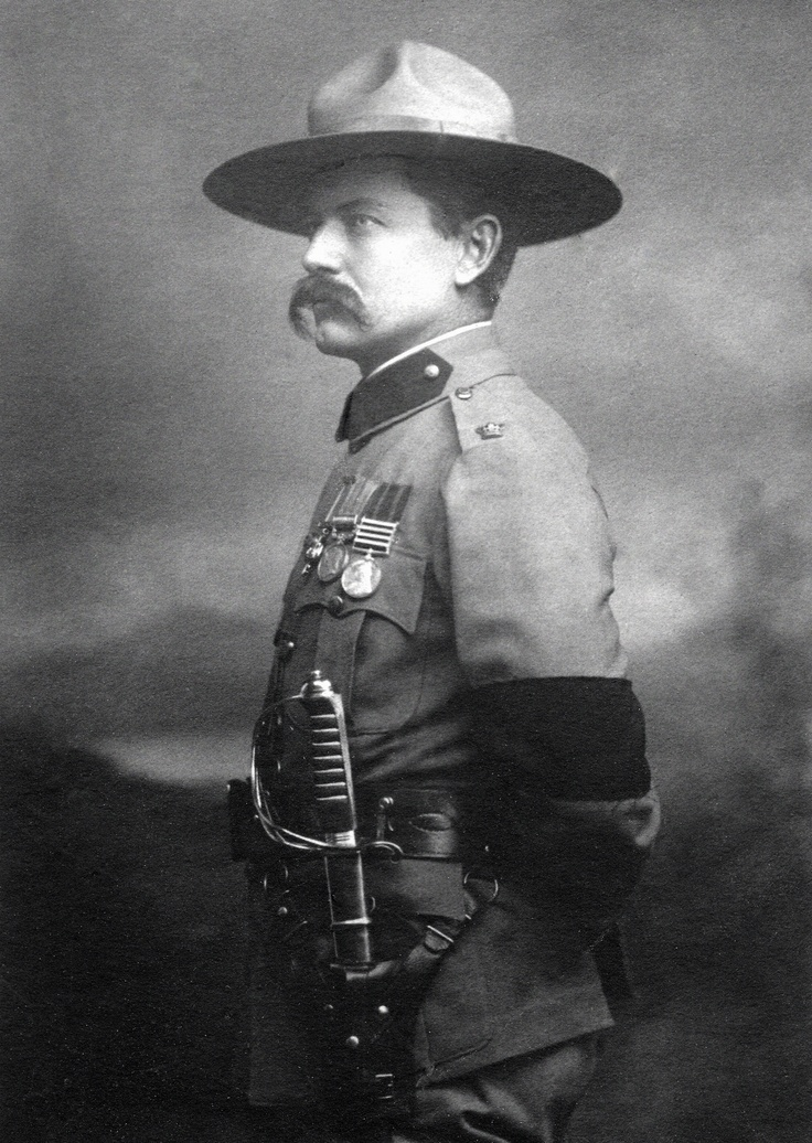 Major Frederick Russell Burnham photograph taken in London on the day he received from King Edward VII the cross of the Distinguished Service Order for his heroism during the March to Pretoria during the Second Boer War. Burnham's two other medals shown in photo: the Queen's South Africa Medal with four bars, Johannesburg,Paardeberg, Cape Colony, and the British South Africa Company Medal, earned in the First Matabele War. The black armband was worn in mourning for Queen Victoria.