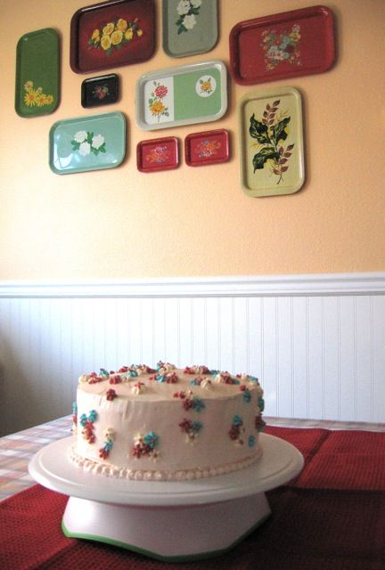 The cake is beautiful, but I LOVE the vintage trays on the wall!