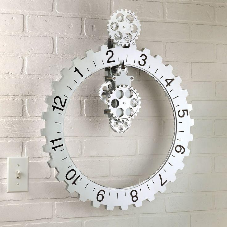 The Hands Free Gear Clock - Hammacher Schlemmer. IF only it were actually metal.