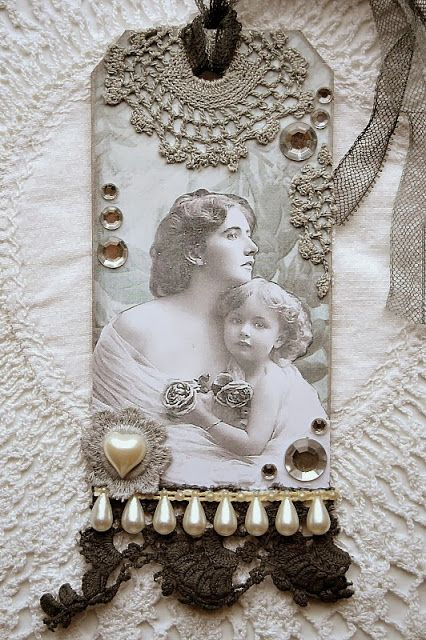 Tag - mother and child. Notice the bits and pieces of vintage lace used.