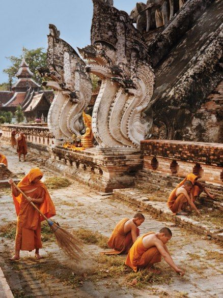 Monks sweep and weed the grounds at Wat Chedi Luang, in the center of old Chiang Mai. The temple was the tallest building in the Lanna kingdom until the top collapsed in the sixteenth century.