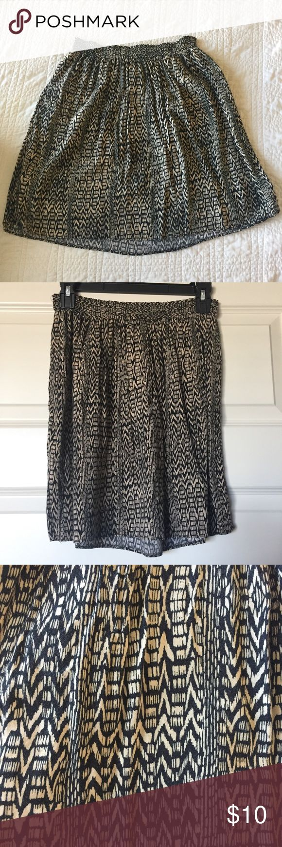 Tribal Print Skirt Brown and black tribal print skirt with pockets. Soft flowy material and elastic waistband. Washed and worn a couple times and in great condition! Make an offer! Bundle 2 or more items and save 10% plus combined shipping! Mossimo Supply Co. Skirts