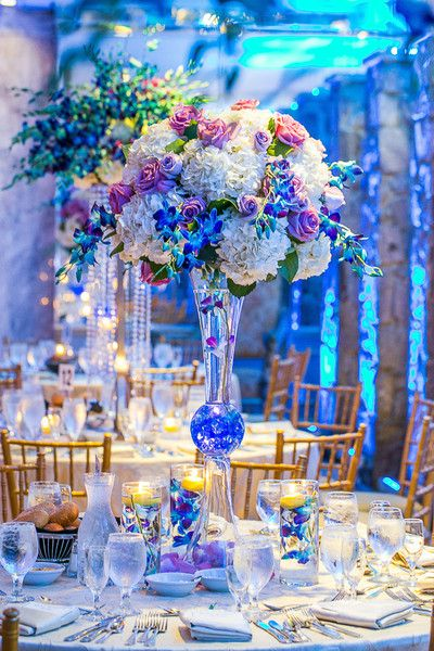 Glam purple and white wedding centerpiece - tall purple and white floral arrangement in tall glass vase {Joshua Zuckerman Photography}