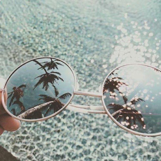 Reflection #palmtrees #sunglasses #pool #cristalclearwater #bluesky